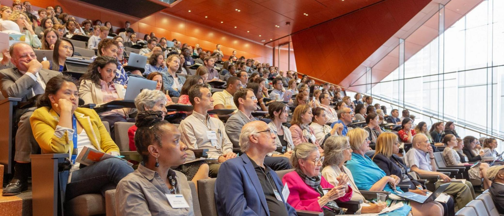 People in an auditorium attending a seminar
