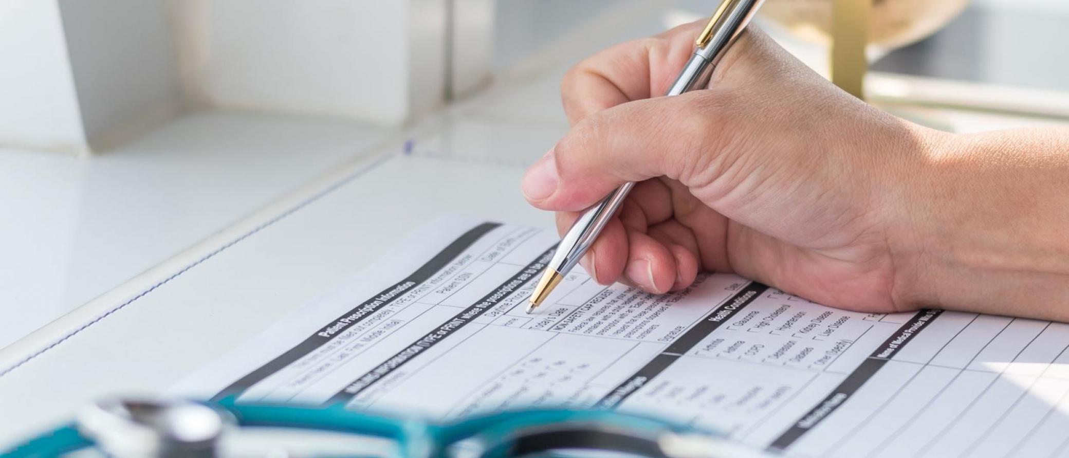 Hand of a doctor writing a prescription